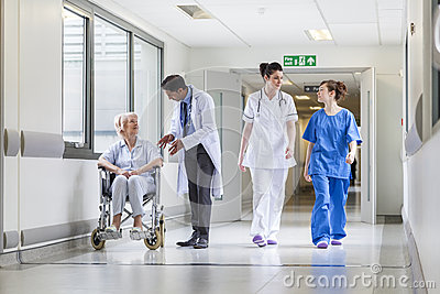 Doctors Nurse senior Female Patient in Hospital Corridor