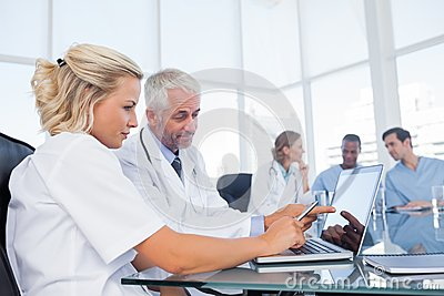 Doctors using a laptop