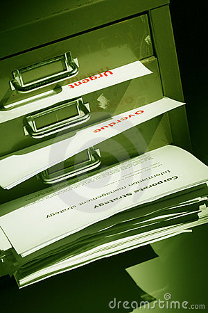 Documents bulging out of a filling cabinet