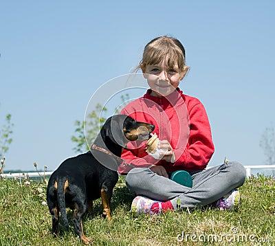Dog eating icecream from girl
