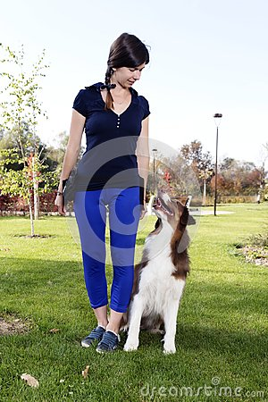 Free Dog Girl Female Training Animal Pet Australian Shepherd Professional Trainer Handler Relationship Outdoor Park Practice Royalty Free Stock Photo - 104952175