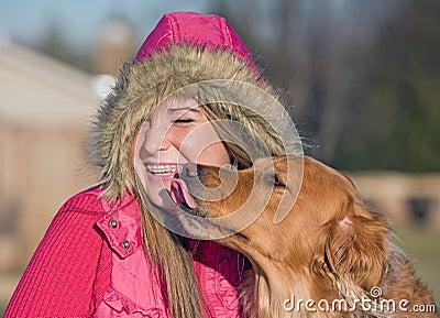 Dog Kissing Teenage Girl