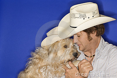 Dog and man wearing cowboy hat