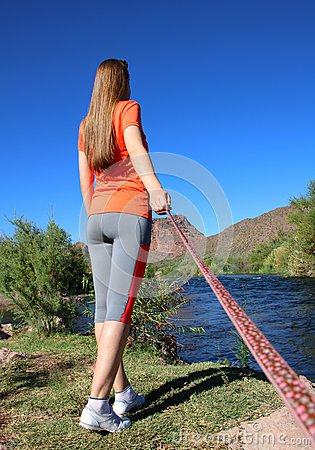 Free Dog Perspective Of A Woman And A River Stock Photo - 77363810