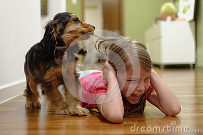 Dog pulling girl s hair
