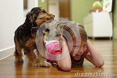 Dog pulling girls hair