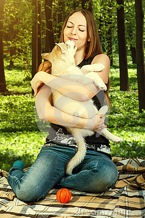 Free Dog Puppy Playing With Young Happy Woman Stock Photos - 52799803
