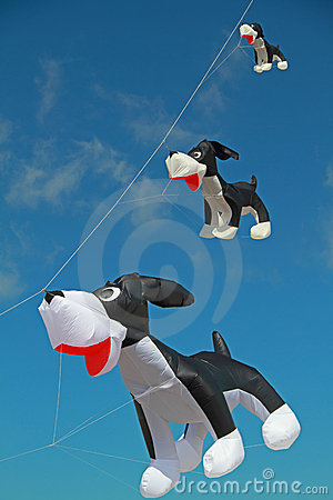 Dog shaped Kite flying in clear blue sky