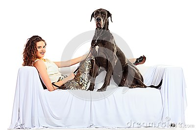beautiful young woman posing with her great dane dog isolated over