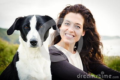 Dog and woman travel portrait