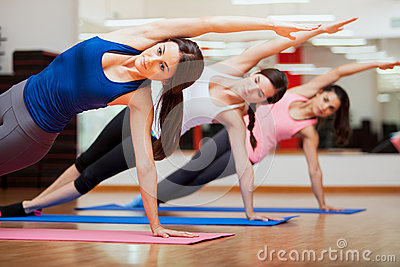 doing a side plank for yoga class stock image  image