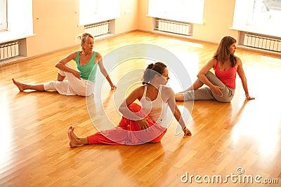 Doing yoga in health club