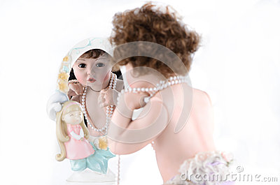 Doll with mirror