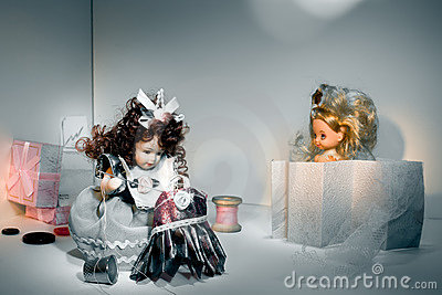 The doll sews a dress