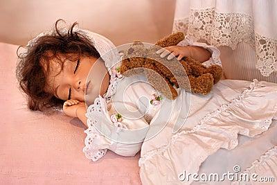 Doll Sleeping with Teddy Bear