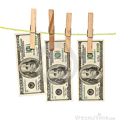 Dollar banknotes drying  on rope