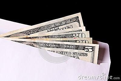 Dollar banknotes in envelope