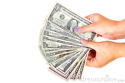 Dollar banknotes in female hand