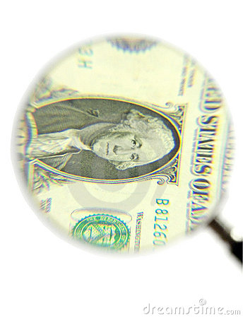 Dollar bill and magnifying glass
