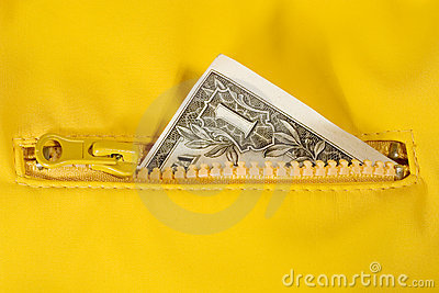 Dollar bill in the zipper