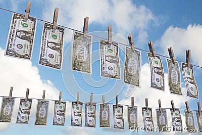 Dollar bills on clothing line