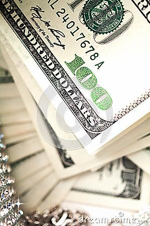 Dollar bills with diamonds detail