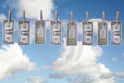 Dollar bills hanging on clothes line