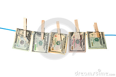 Dollar bills drying on a rope