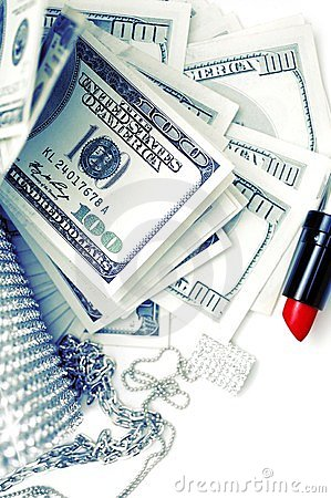 Dollar bills with luxury accessories