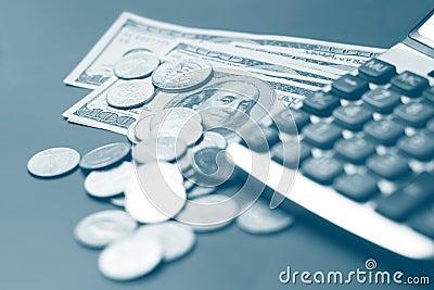 Dollar coin and a calculator