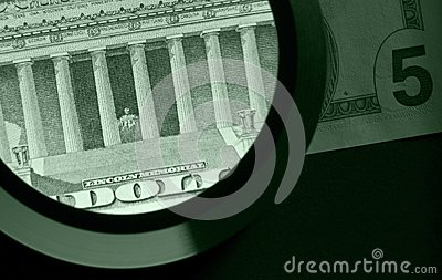 Dollar and magnifier