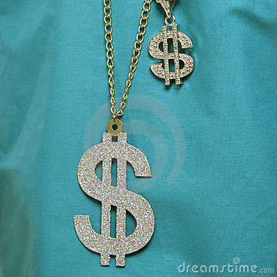 Dollar sign necklace.