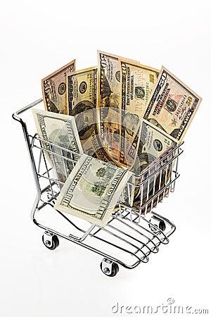 Dollari di Stati Uniti dei soldi con il cestino di acquisto