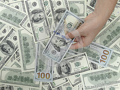 100 Dollars Bills and 1 hand Background