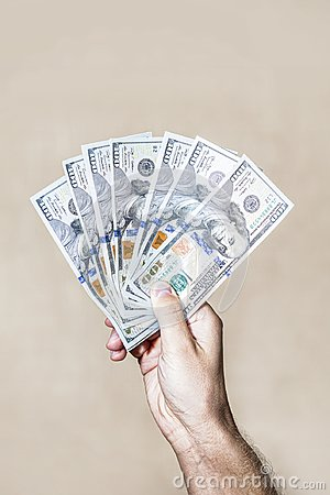 Free Dollars Fan The Bills One Hundred Dollars In Hand Stock Photography - 104077282
