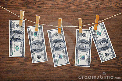 Dollars Hanging on Rope with Clothespins