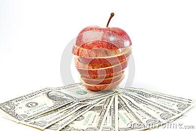 dollars lays on an apple