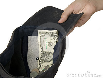 Dollars placed on cap which is held by man