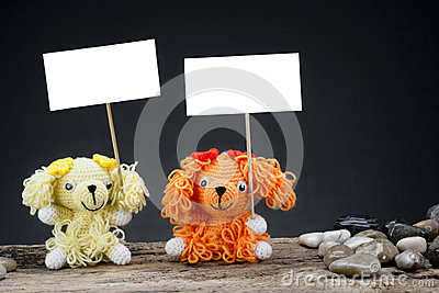 Dolls dog holding a placard