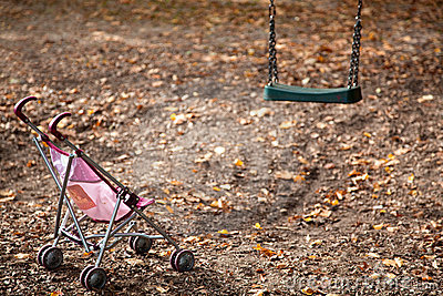 Dolls pram on empty playground