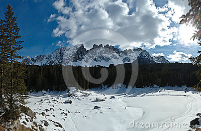 Dolomites caress frozen lake