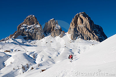 Dolomites covered by snow and sporty people with s