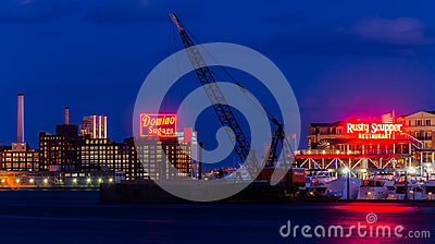 Domino Sugars Factory and Rusty Scupper Restaurant at night, Baltimore, Maryland Editorial Stock Photo