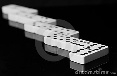 Dominoes on black shining surface