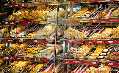 Donuts in window shop. Editorial Stock Photo