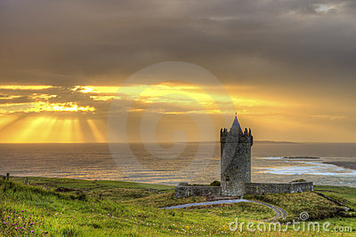 Doonagore castle at sunset in Ireland.