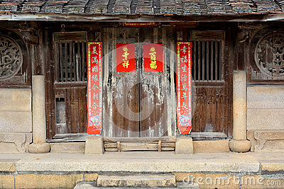 Door of aged and traditional residence in countryside of South of China Editorial Image