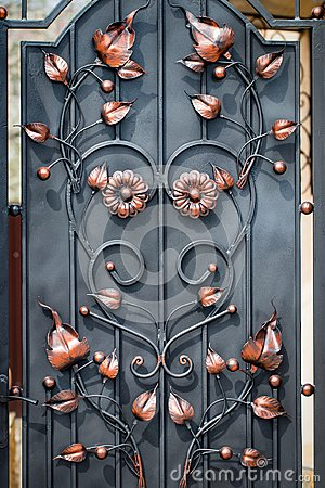 Free Door Decoration With Ornate Wrought-iron Elements, Close Up Stock Photo - 114831310