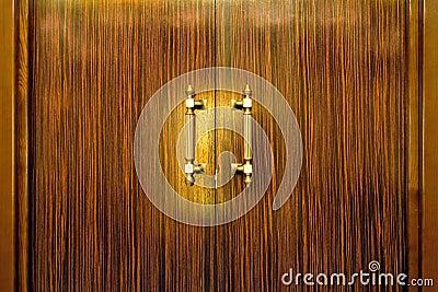 Door handle on the wooden doors