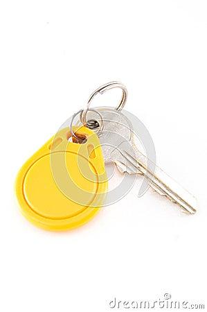 Door keys and circle yellow key card Stock Photo
